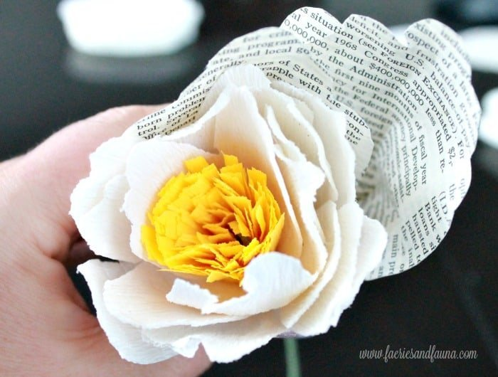 First two book page petals being added to a home made crepe paper peony craft.