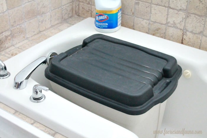 Large Rubbermaid container used for making bleached drop cloths.