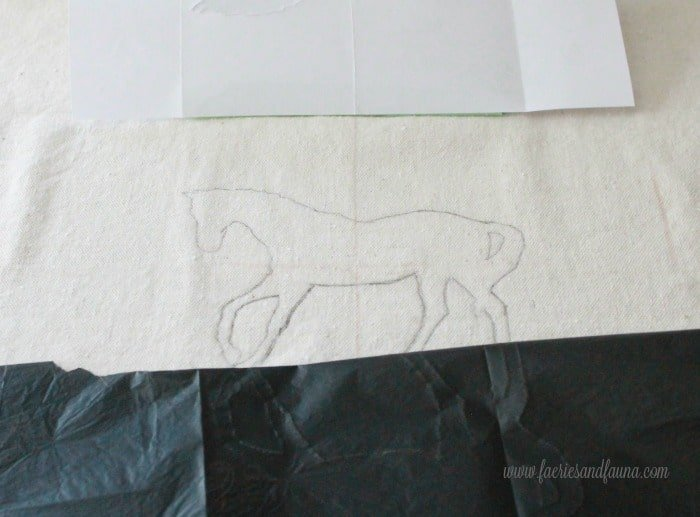 Aligning a stencil and a piece of carbon paper to center. Cushion making, DIY cushion covers, DIY pillow, making pillow covers, cushion cover making, sewing pillow covers, envelope cover, DIY Cushion Covers