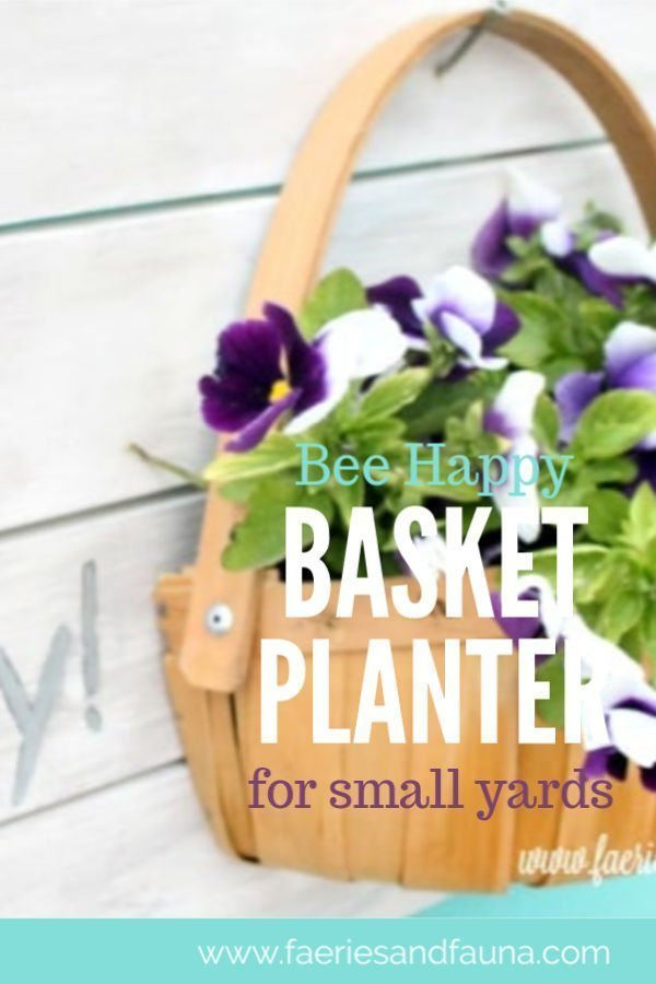 Wood and basket plant hanger for small yard or balcony.