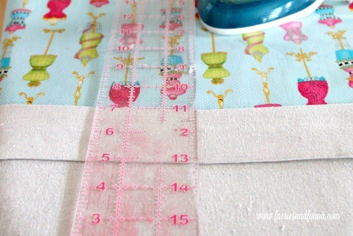 Folding and ironing the edges of the basket liner. DIY wire baskets, DIY baskets, how to make wire basket, DIY storage baskets,