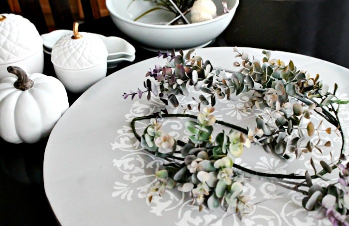The first layer of greenery in a DIY Fall centerpiece.