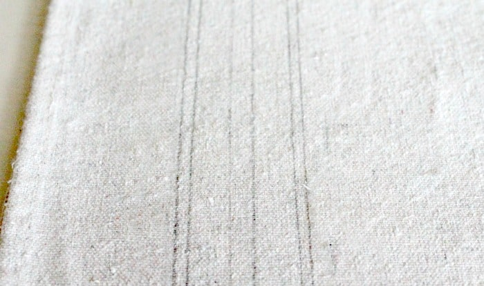 Pencil drawn stripes on drop cloth fabric for a Farmhouse bulletin board makeover
