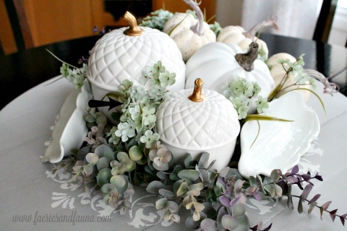Filling in gaps and spaces in a Fall centerpiece.