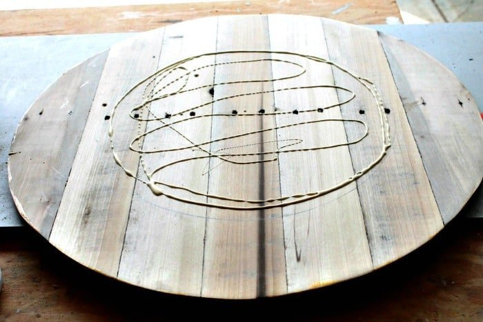 Attaching pieces of a large lazy susan together with wood glue.