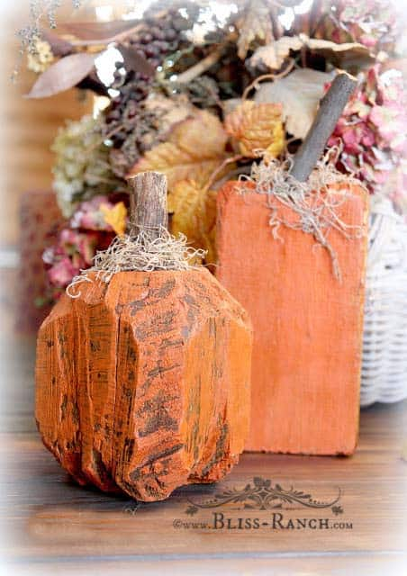 DIY carved wood pumpkins in traditional colours.