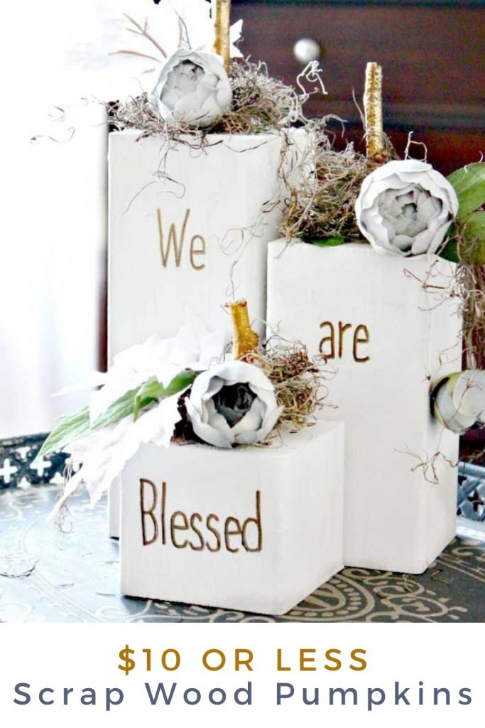 Three modern farmhouse neutral DIY wood block pumpkin signs. The pumpkins are white with gold stick stemps and say We are Blessed
