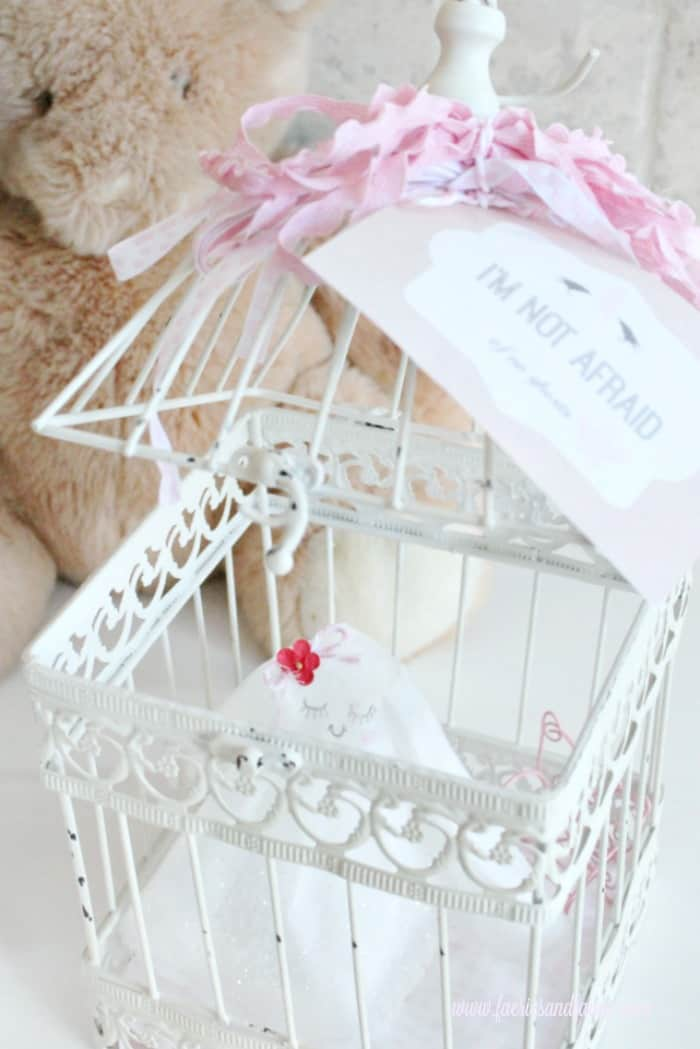 A Not Scary Halloween decoration of a little ghost in a cage.