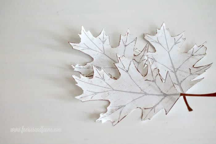 Free printable of fall leaves cut out for making a fall banner.