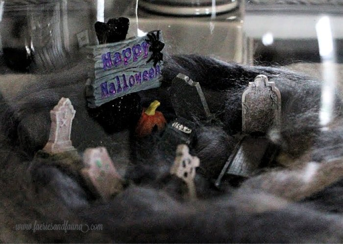 A graveyard arrangement for inside a Halloween apothecary jar.