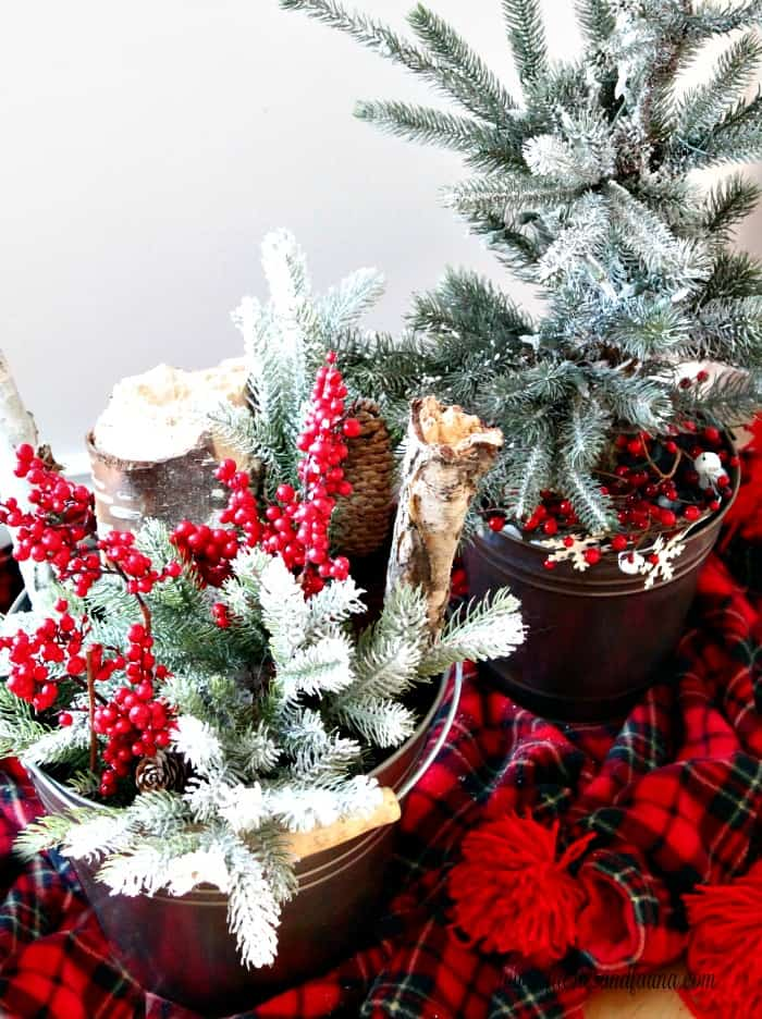 Christmas arrangements made with aged metal buckets