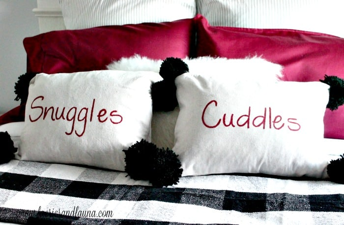 Handmade Christmas Cushions that say Snuggle and Cuddle with Black Pom Poms for Christmas.