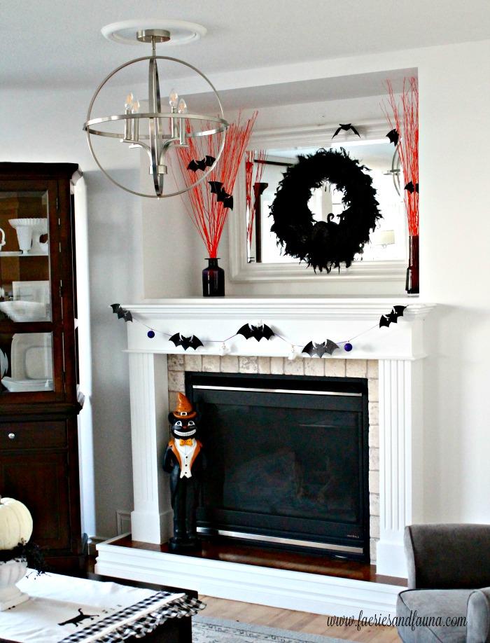 DIY Halloween Fireplace mantel decorated with Halloween craft ideas.
