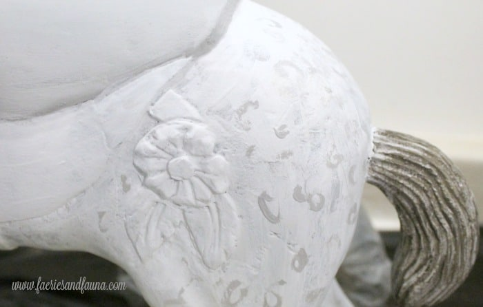 Painted dapple swirls of grey paint on a Vintage Toy horse
