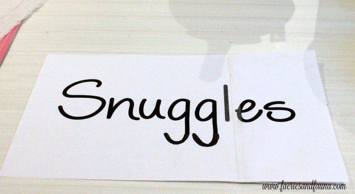 Centering a template for DIY Pillow, that says Snuggles