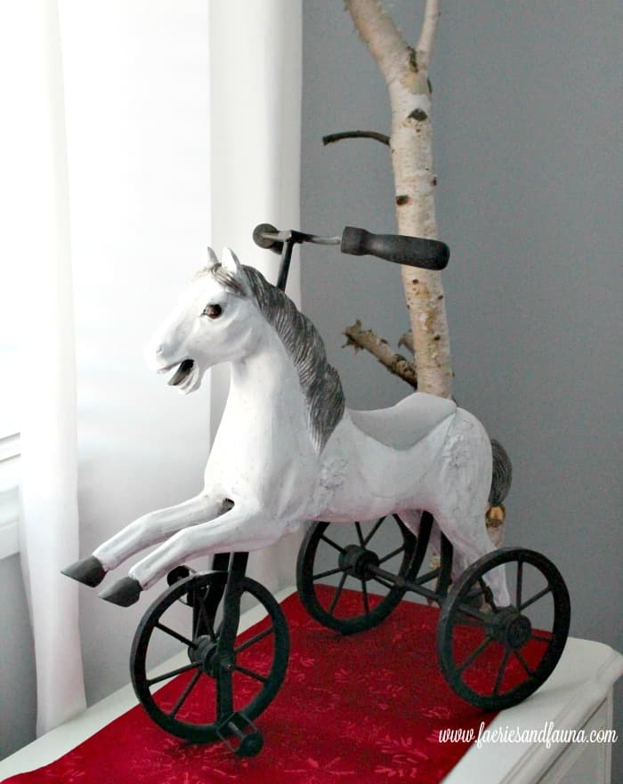 Vintage toy for under the Christmas tree, a little horse tricycle repainted in dapple grey.