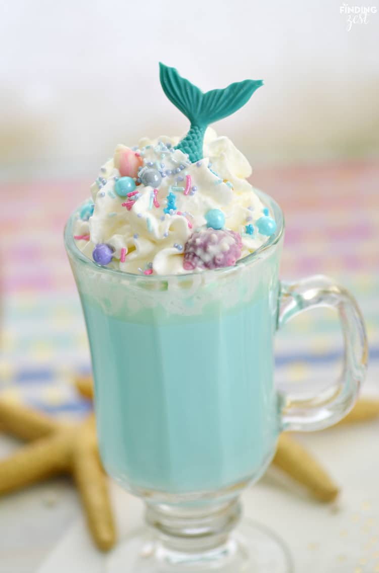 Blue Mermaid hot chocolate with whipped cream, sparkles and mermaid spoons.