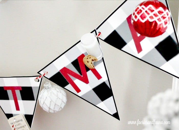 Christmas Banner in buffalo check with Santa stickers for an Easy Christmas craft for kids