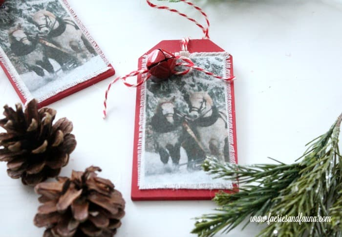 Handmade DIY Christmas ornament in red with white fabric and horses.