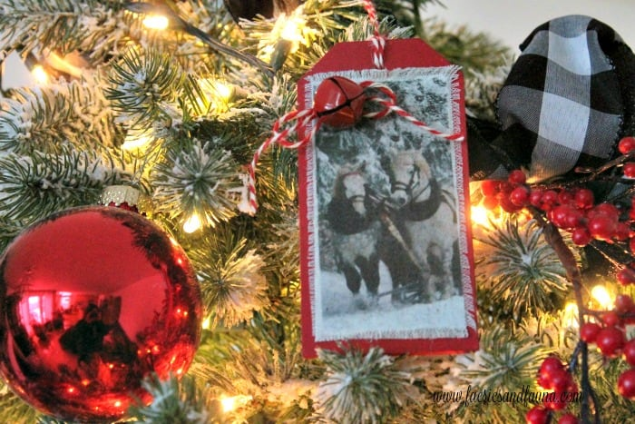 A DIY Christmas ornament with horses and sleigh bells for a Christmas tree