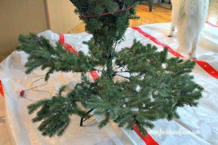 Fluffed artificial tree before DIY Christmas tree flocking.