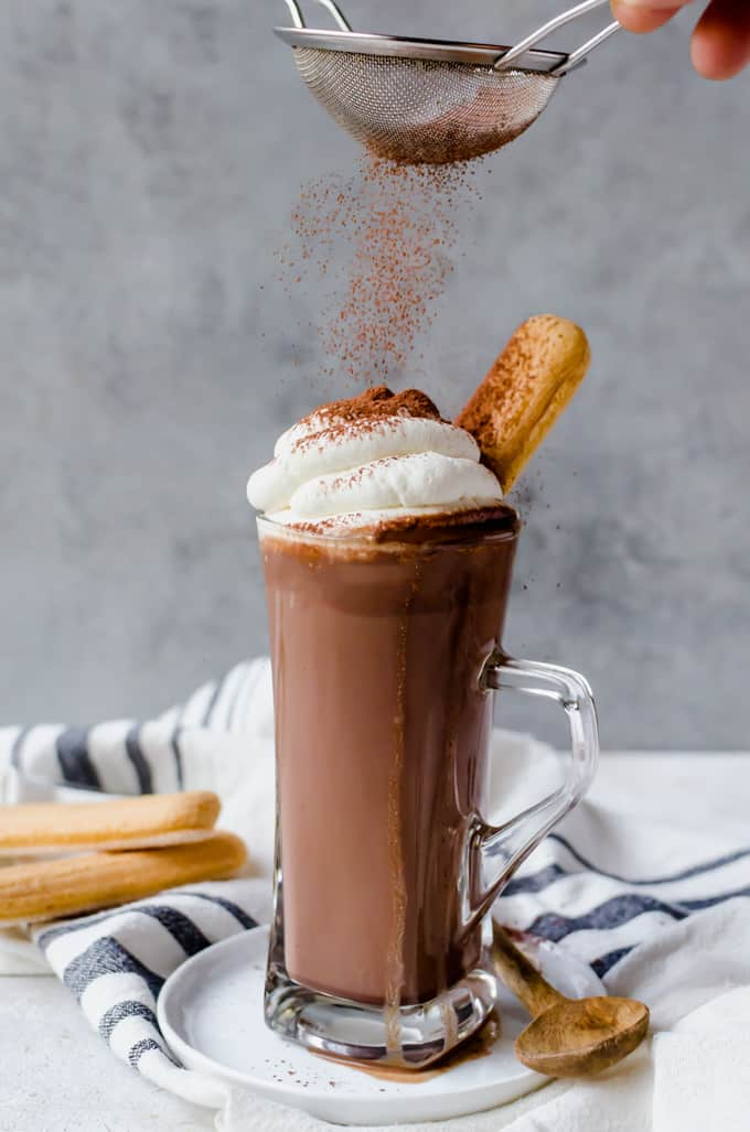 Chocolate sprinkles on top of a gorgeous mug of homemade hot chocolate.