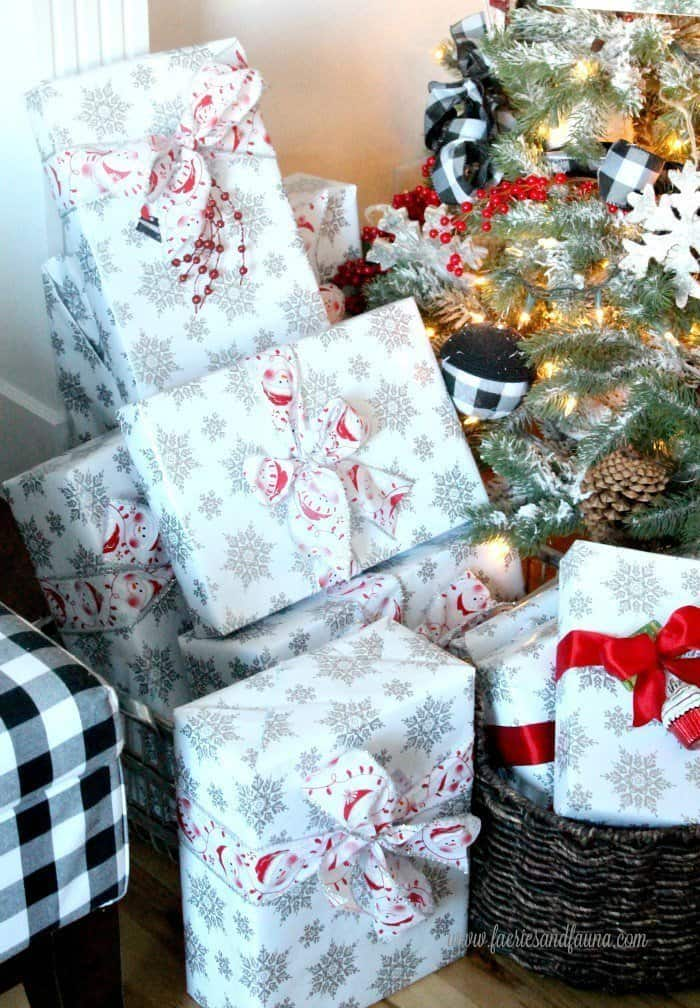 Gift wrapping under the Christmas tree. The presents are bright and cheerful for children.