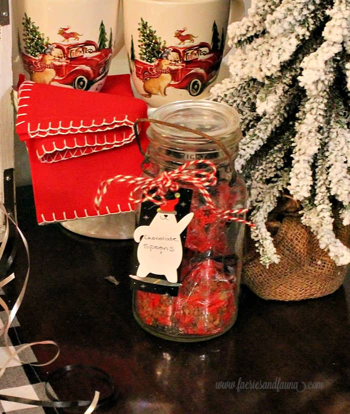 Christmas mason jar with chocolate covered spoons.