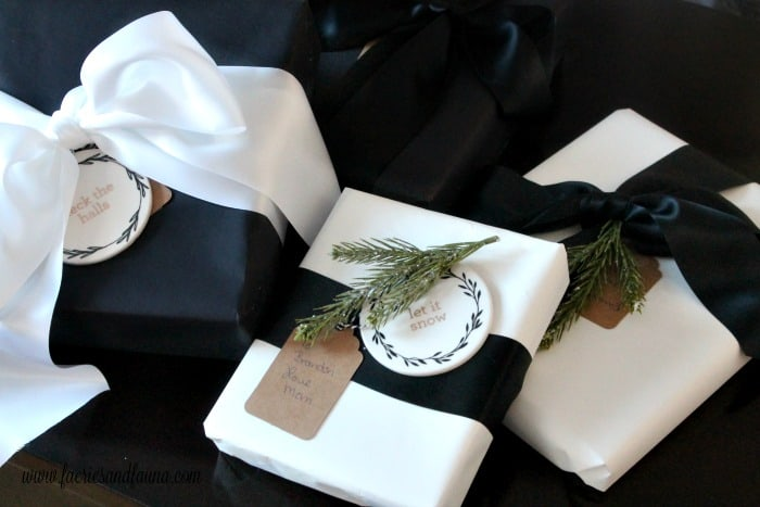 Gift Wrapping in black and white matte paper with shiny satin ribbon.