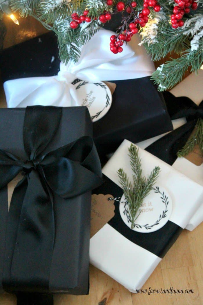 Gift wrapping for Christmas. Wrapping presents in an elegant black and white style