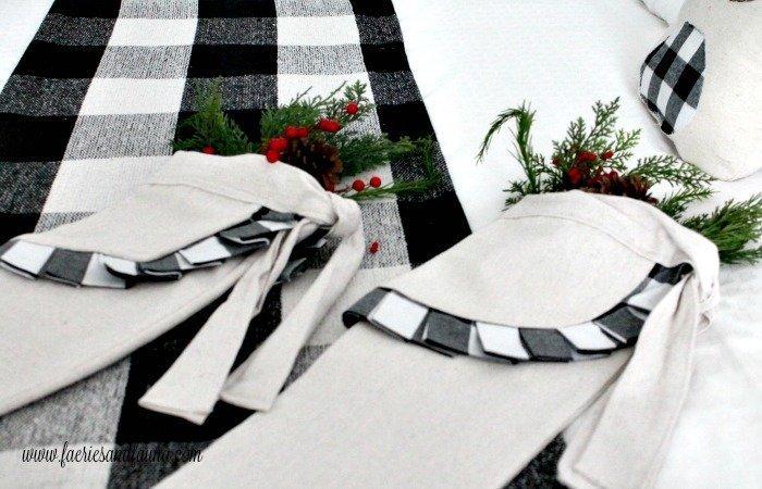 Farmhouse styles white and black buffalo check Christmas stockings.