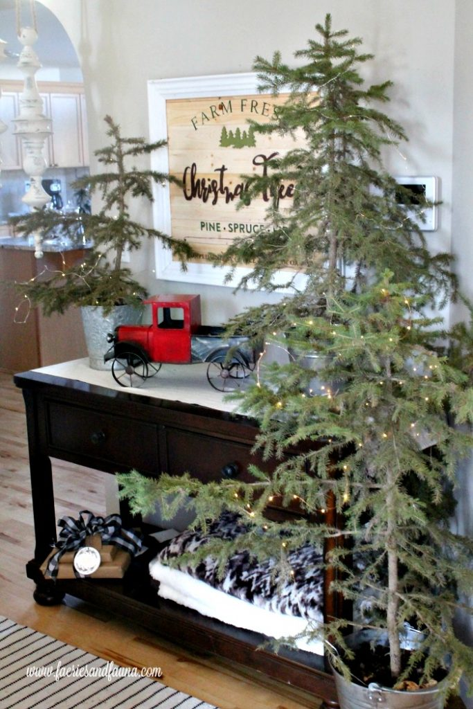 Fresh Christmas Trees with a DIY Farmhouse Sign focal point.