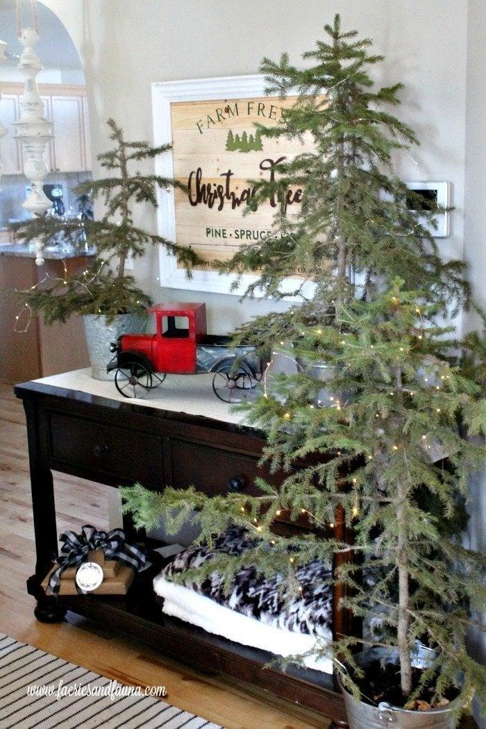 Fresh Christmas Trees with a DIY Farmhouse Sign focal point.