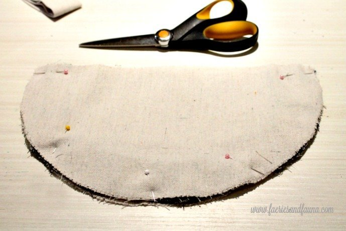 Sandwiching buffalo check pleats between two layers of drop cloth.