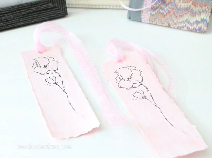 Two feminine DIY bookmarks with pink ribbons.