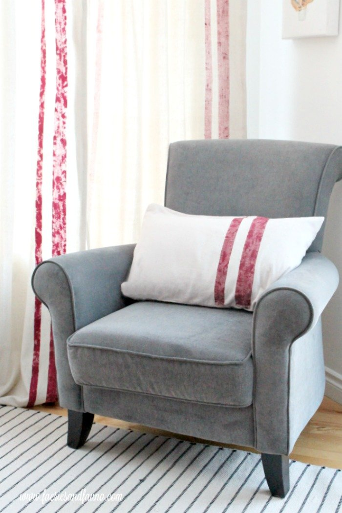 Living room chair with drop cloth curtains and DIY cushion cover.