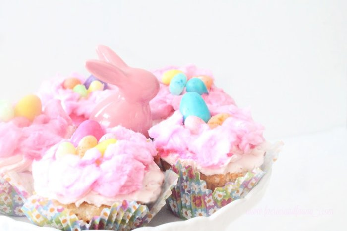 Easter cupcakes with cotton candy nests, jelly bean eggs and strawberry cupcakes.