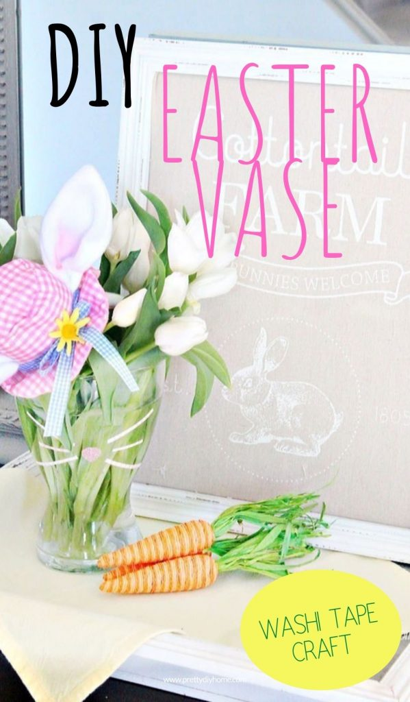 A glass vase with washi tape Easter bunny nose and whiskers with fresh flowers for Easter