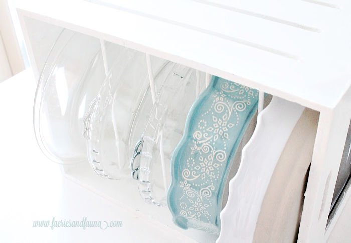 DIY storage boxes with dividers for holding pantry items.