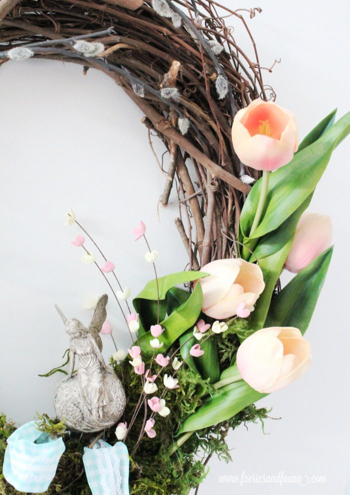 Adding faux tulips to a DIY Spring wreath craft.