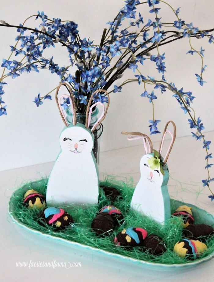 An Easter centerpiece made with DIY wooden bunnies and Easter eggs