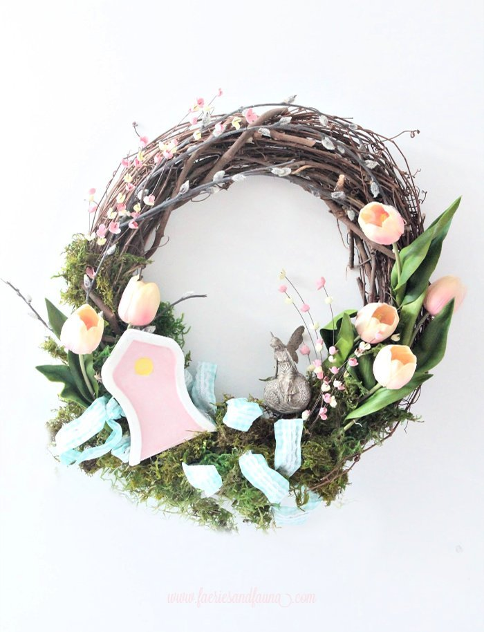 A colourful Spring wreath craft with a fairy garden.