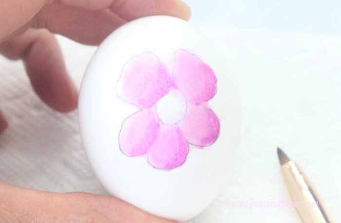 Filling in a floral watercolor Easter egg petal using water. Making some DIY watercolor Easter Eggs with florals.