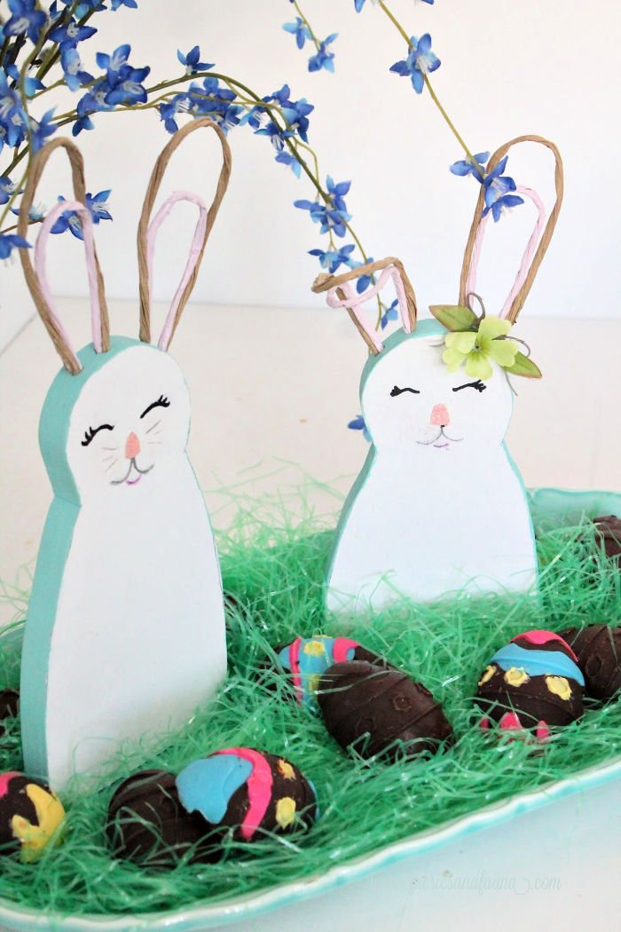 An Easter centerpiece featuring DIY wooden Easter bunny with bendable ears