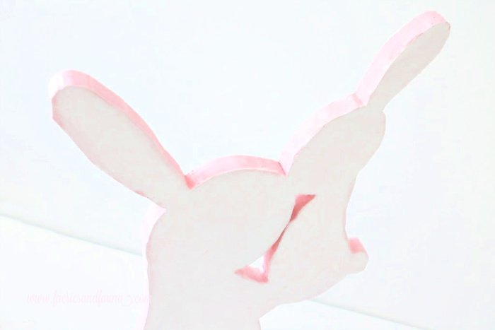 Painting the edges of a DIY Easter Bunny. Making a bunny out of wood.