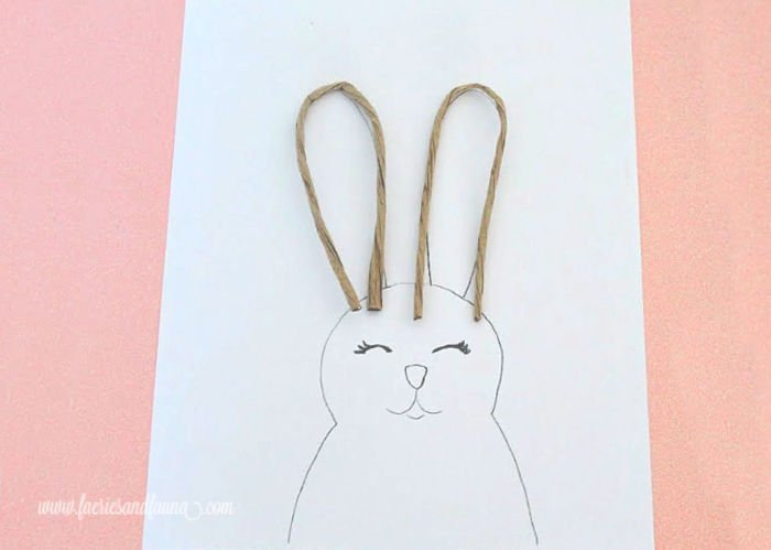 How to make DIY wire Easter bunny ears on a wooden Easter bunny craft. A free printable pattern for making adjustable ears and a wooden Easter bunny.
