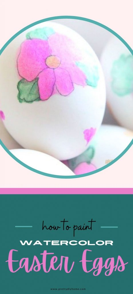 White Easter eggs with pink and green watercolour flowers and leaves.