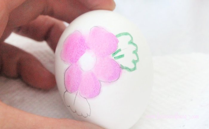 Painting leaves on Watercolour egg florals. Making DIY watercolor Easter eggs with flowers.