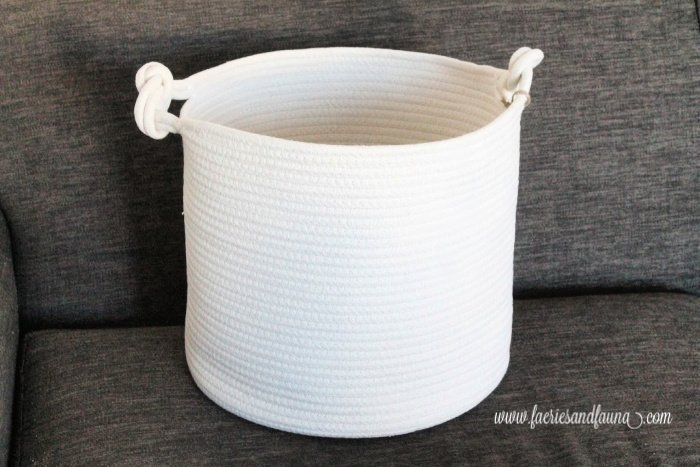A plain fabric basket before decorating with ribbon embroidery tulips.
