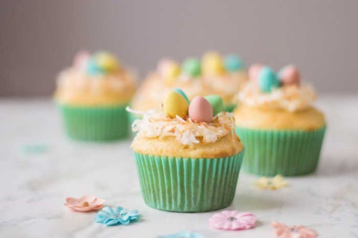 Homemade Cupcake Recipe for Spring or Easter with Easter eggs and pretty pink icing.